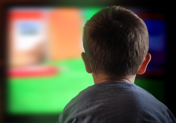 Young boy watching television. © Angela Waye | shutterstock.com