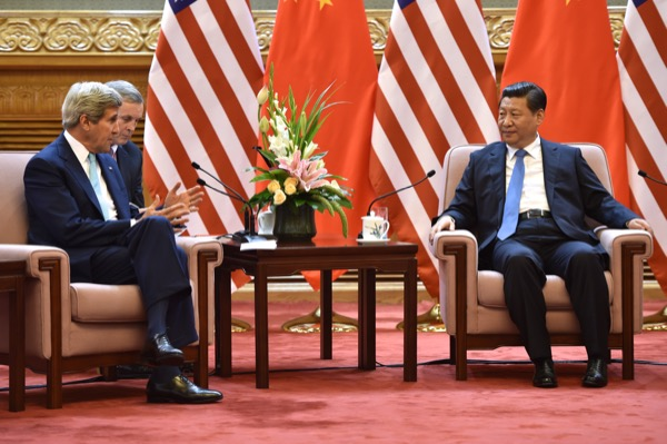 U.S. Secretary of State John Kerry speaks with Chinese President Xi Jinping. Tensions are rising between the two nations as China warns U.S. it could spark war due to provocative acts in South China Sea. (accessed via Wiki Commons).