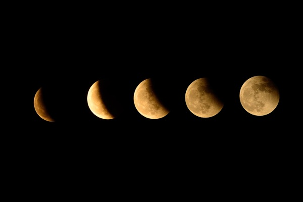The stages of a lunar eclipse. Blood moons are total lunar eclipses. © Sarit Wuttisan | Shutterstock.com