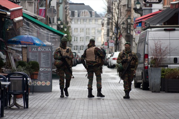 BRUSSELS - NOVEMBER 22: Belgium Army patrolling on a street near Avenue Louise in the city center of The problem of terrorism has now moved to Europe, with attacks in Paris and Brussels showing it to be a global problem. User CRM | Shutterstock.com