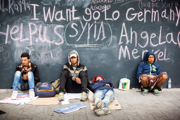 BUDAPEST - SEPTEMBER 4 : War refugees at the Keleti Thousands of migrants have ed Syria to European countries in the hope of a better future. This mass migration has created new issues for the Western world who are trying to accommodate the new ood of citizens from the Middle East. © Istvan Csak | Shutterstock