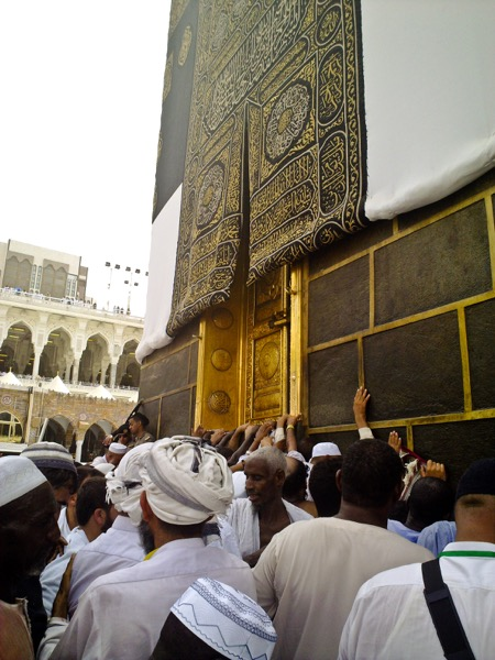 The tawaf is seven circuits around the Ka'bah. Here, pilgrims can be seen in front of the door of the Ka'bah while performing the tawaf. Omar Chatriwala | Al Jazeera English | Released under CC BY-SA 2.0
